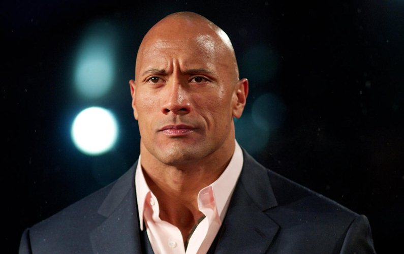 The Rock's new movie co-stars Siri