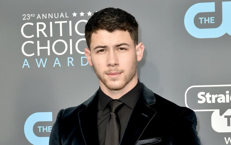 Nick Jonas always carries a suit